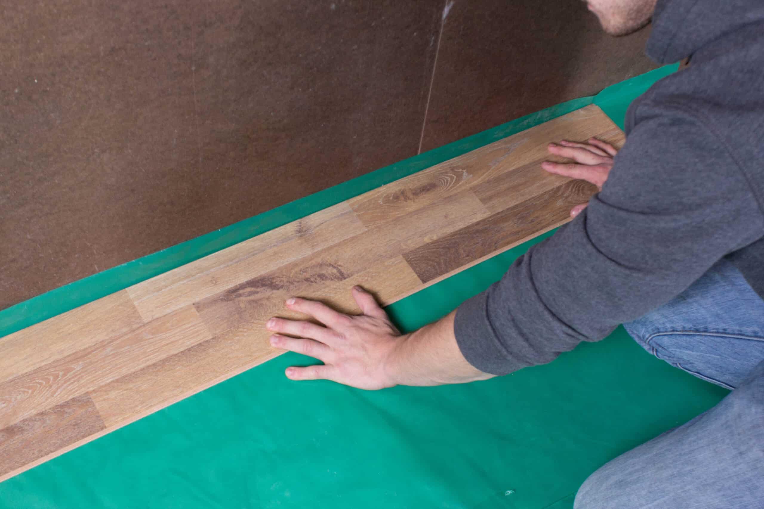 Lay your floor on the top of Visqueen 6Mil PE Vapor Barrier