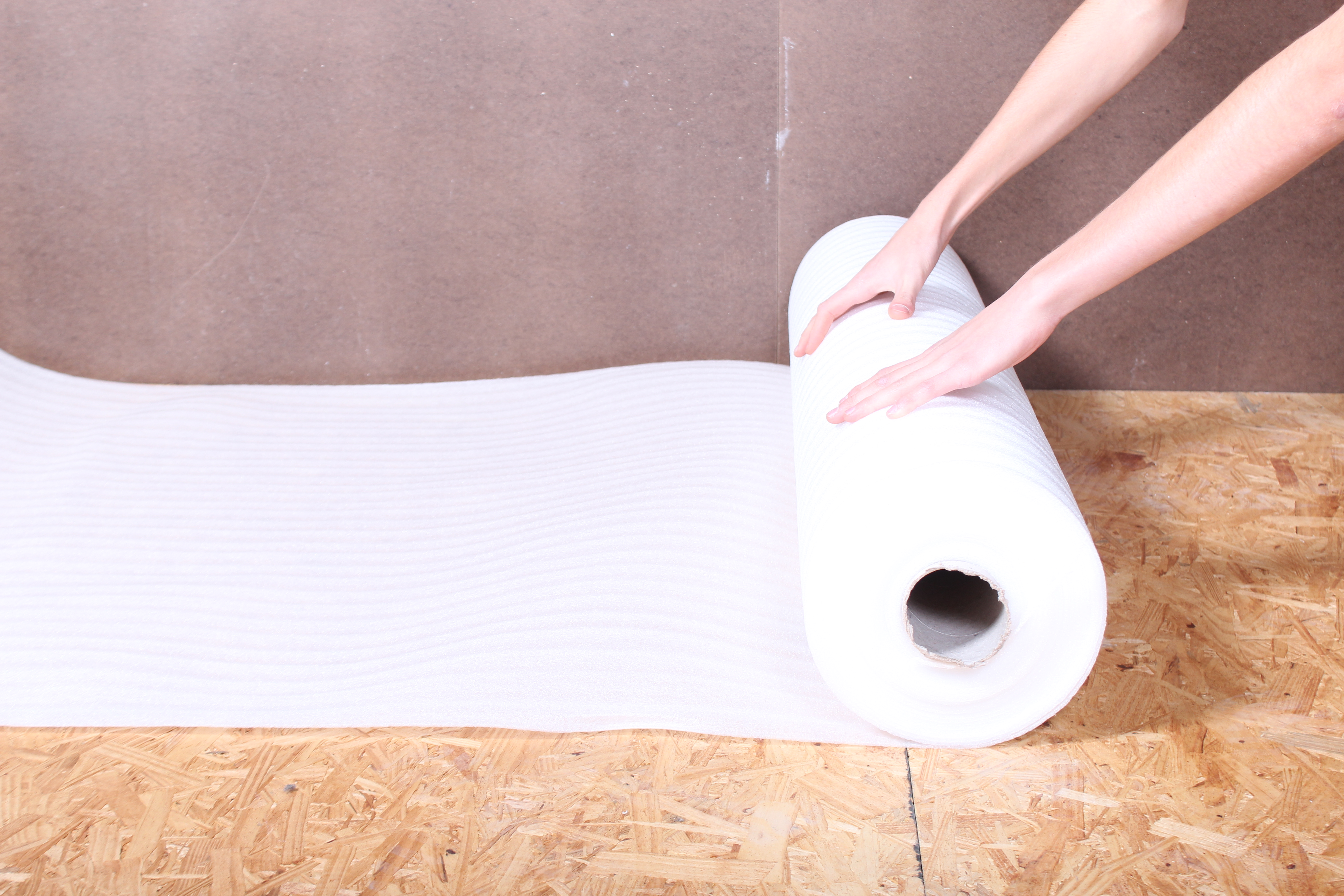 Unroll your first row of standard underlayment