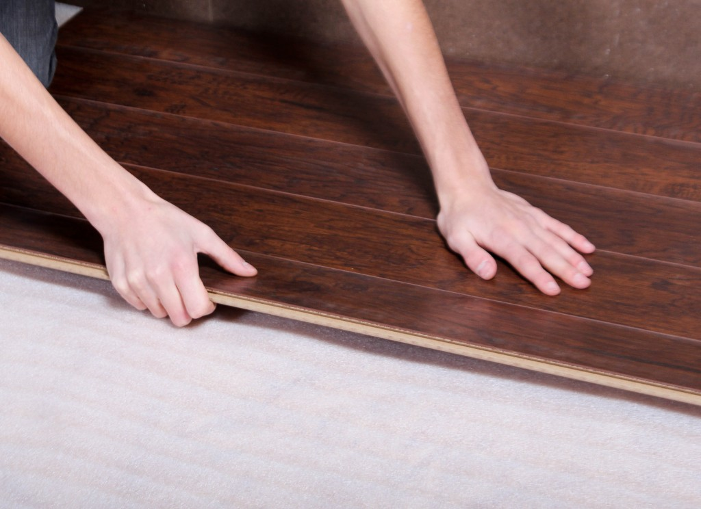 Laminate floors float on top of underlayment.