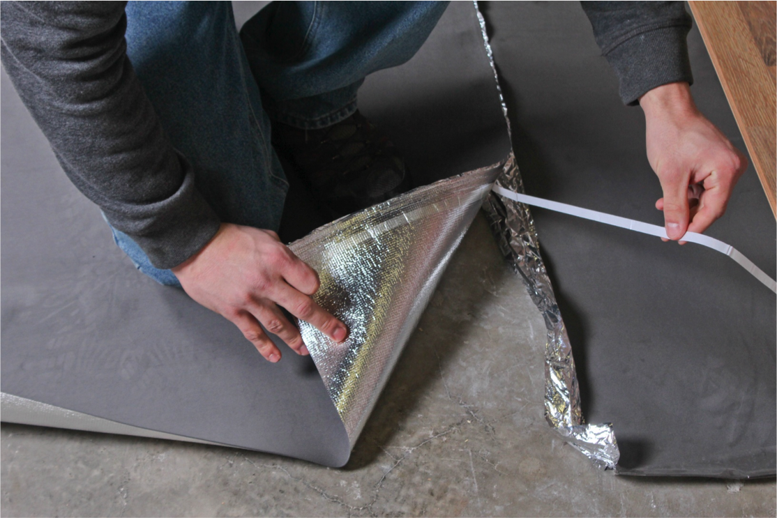 How to Install Vapor 3-in-1 Silver Underlayment - Remove the adhesive from the underlayment