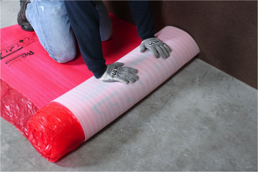 Start unrolling the underlayment