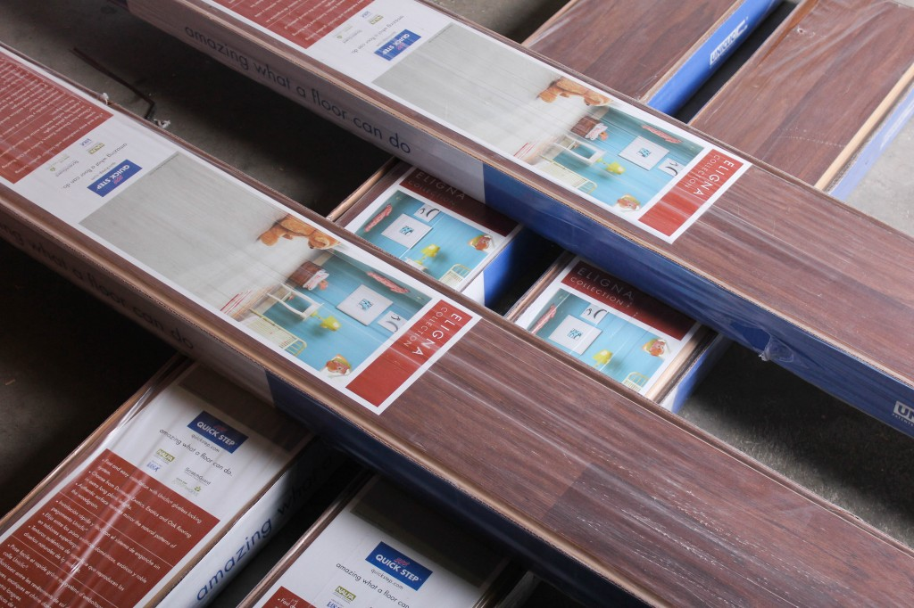 Why does the square feet per box of laminate flooring differ?