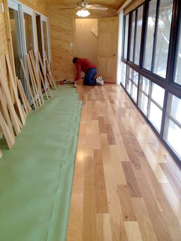 Boyd Hedin installing laminate flooring over Floor Muffler underlayment