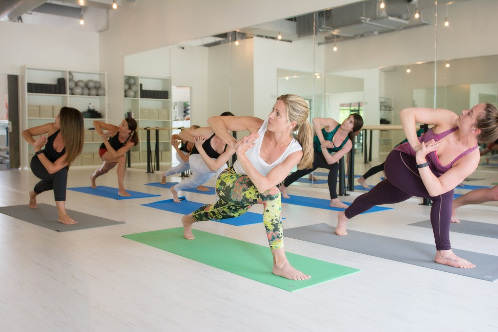 Yoga class at Fit Culture with Quick-Step White Brush Pine Laminate Flooring
