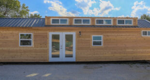 custom container home with rustic vinyl