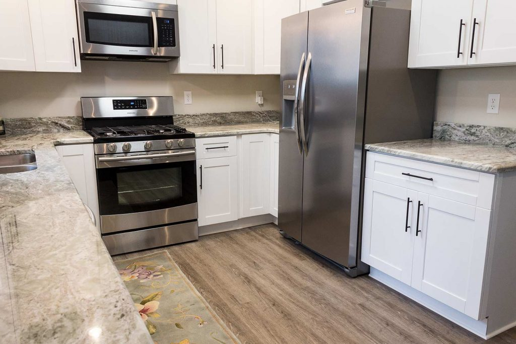 White kitchen with Modern WPC Vinyl flooring