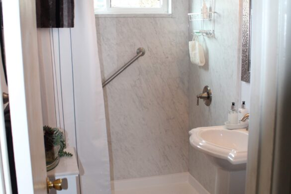 White Bathroom with Vinyl Tile Flooring