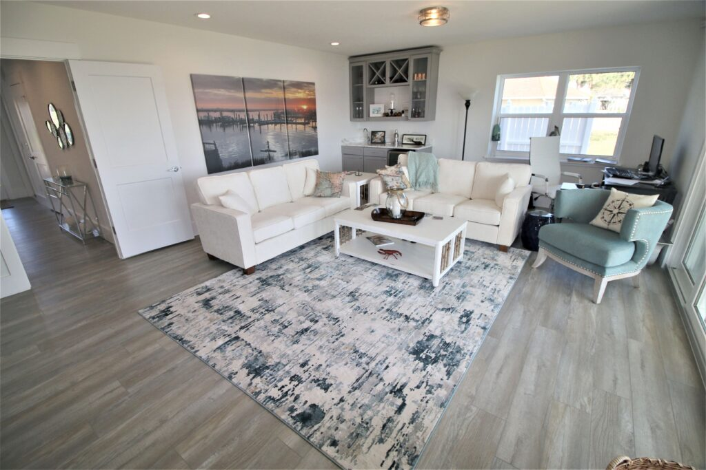 downstairs of beach home with vinyl flooring