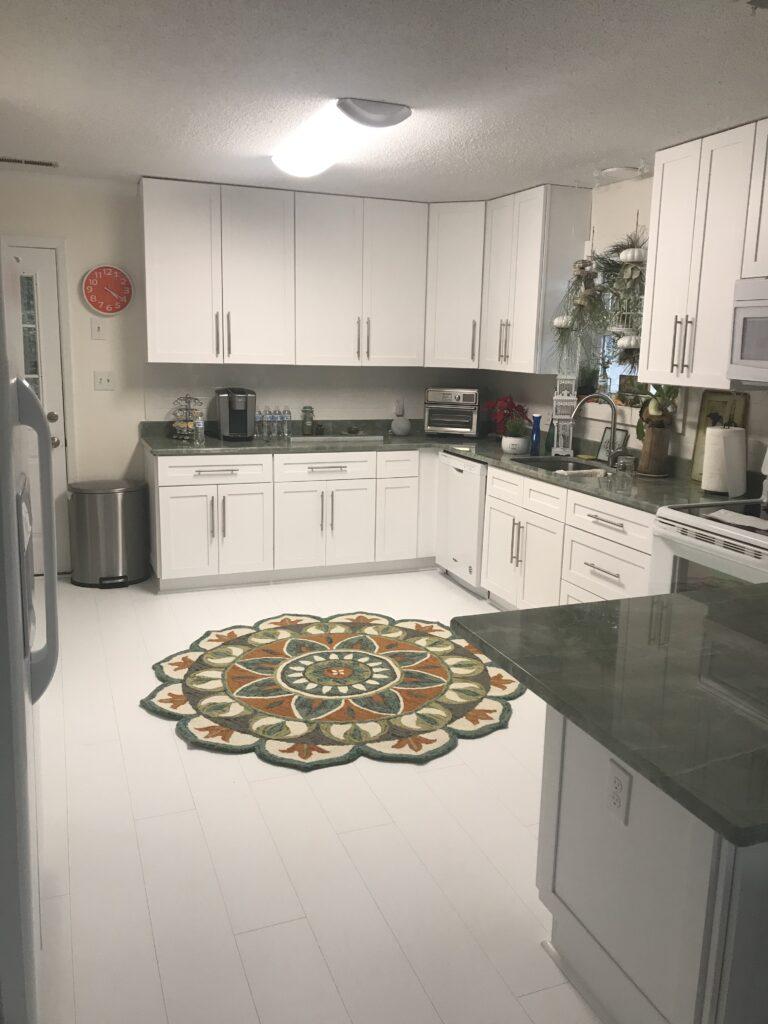 coastal home kitchen with white matte vinyl flooring