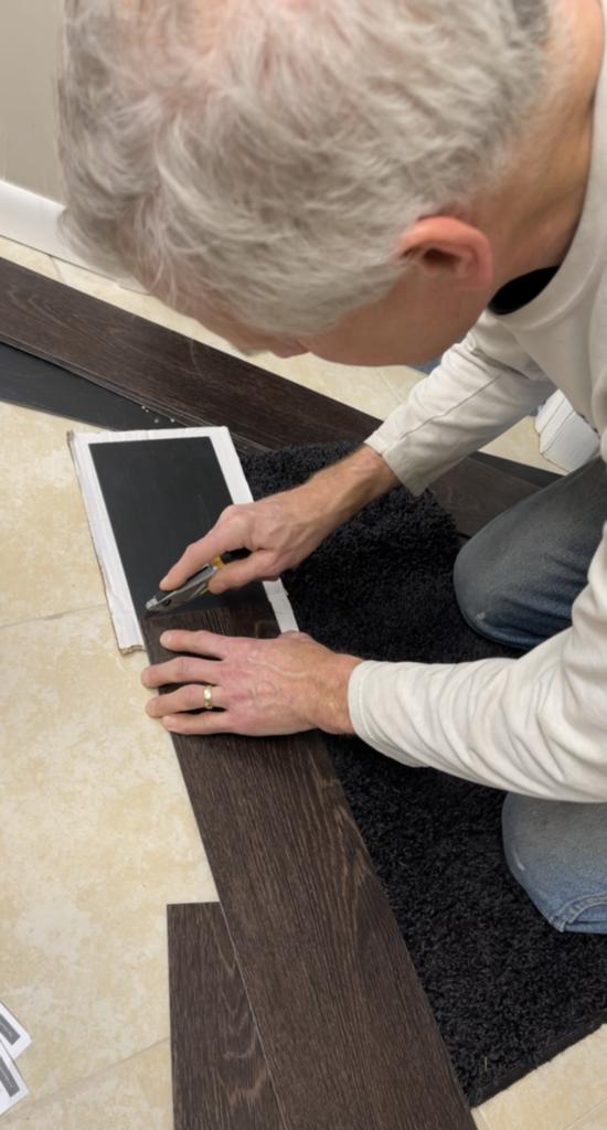 Cutting vinyl glue down planks