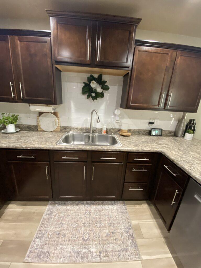 bohemian style house kitchen with vinyl plank flooring