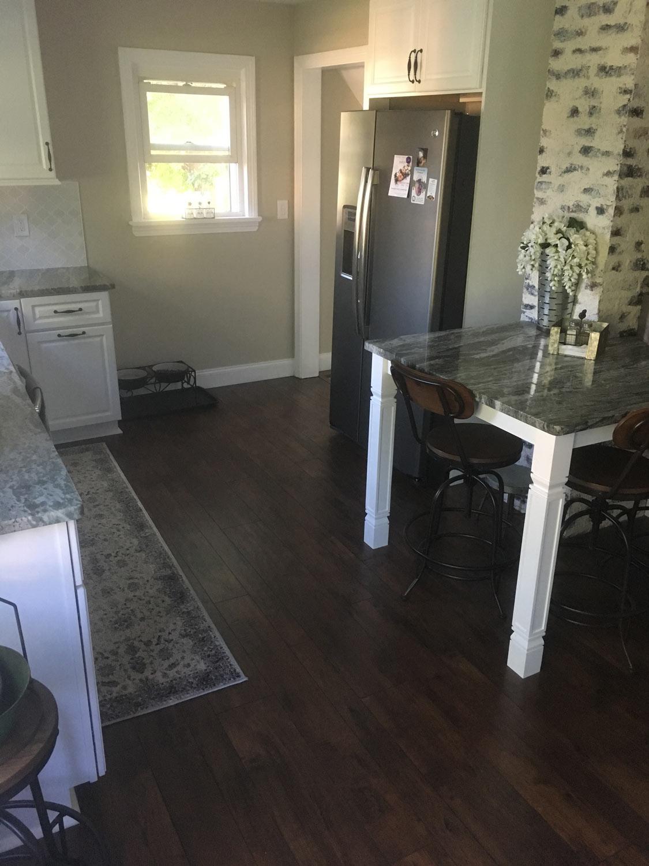 Dark Brown Kitchen Flooring With Light