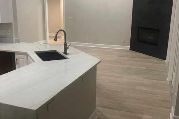 kitchen and living room with bestlaminate sound and heavy coastal beige spc vinyl flooring