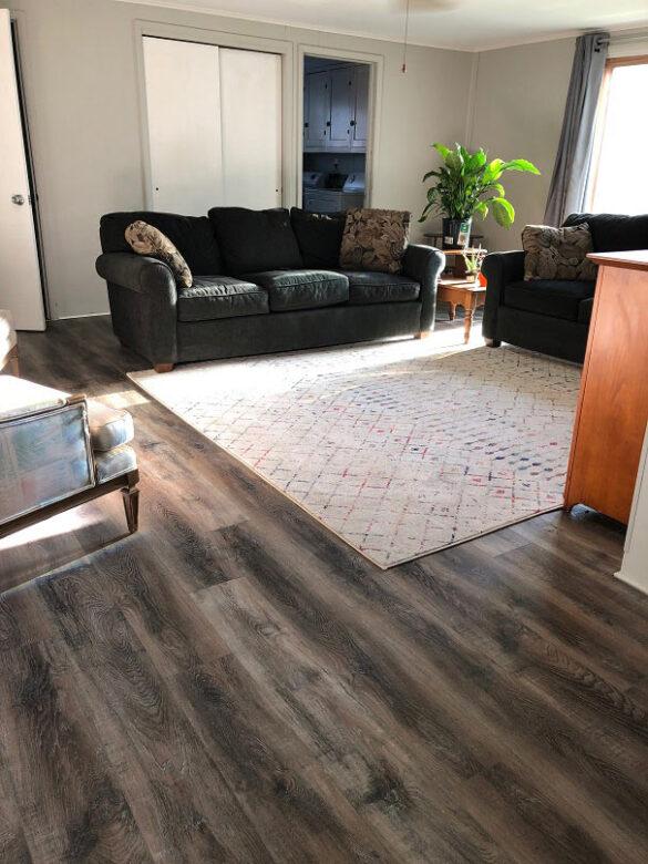living space with bestlaminate sound and heavy sherwood weathered oak spc vinyl flooring