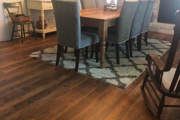 elegant dining room with coretec plus carolina pine vinyl flooring