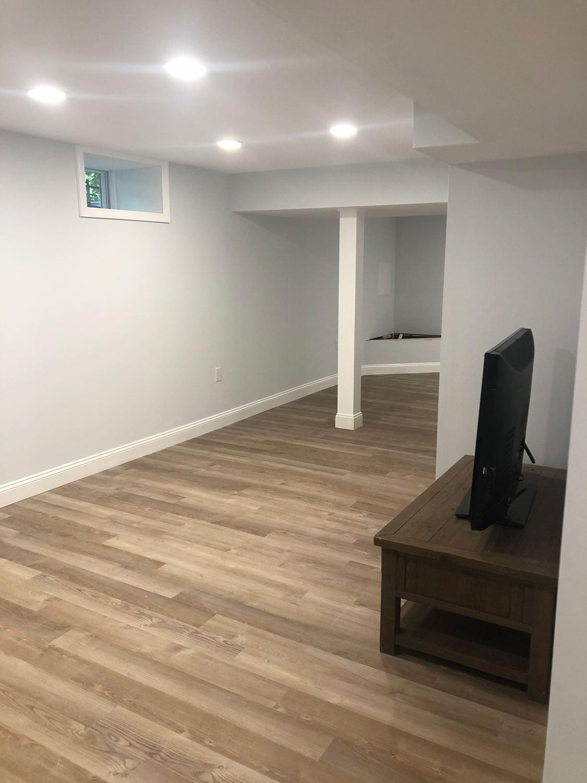 light basement with coretec plus wheldon oak vinyl flooring