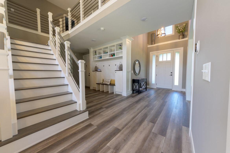 farmhouse foyer with coretec plus xl james river oak vinyl flooring