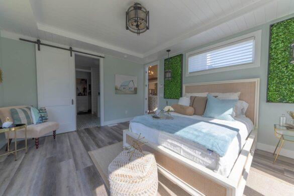 farmhouse master bedroom with coretec plus xl james river oak vinyl flooring