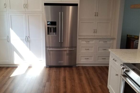 Modern farmhouse kitchen with COREtec PRO Plus Monterey Oak 50RLV1004 SPC Vinyl Flooring