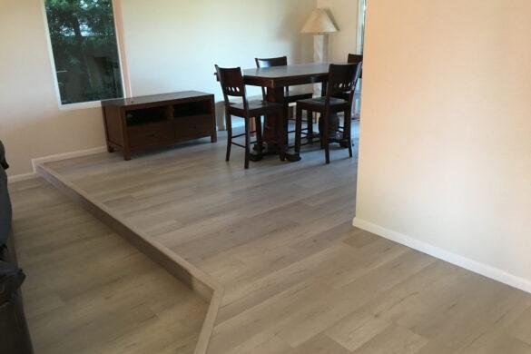 Modern Dining Room with COREtec Pro Plus Quincy Oak 50RLV1018 SPC Vinyl Flooring