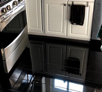 black Kitchen with Elesgo Glamour Life Black Laminate Flooring