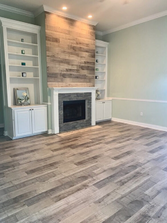 Rustic Fireplace Living Room and Fireplace with Reclaimed Brown Laminate Flooring