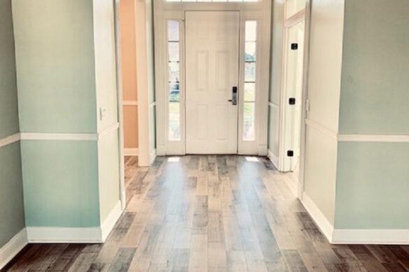 Rustic entryway with reclaimed brown laminate flooring