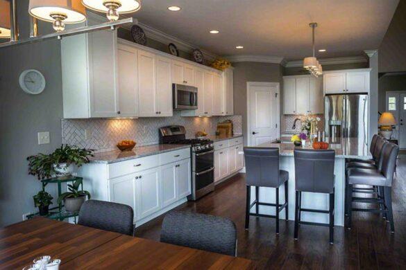 Seamless Dining Room With Dark Chocolate Laminate Flooring bl-000690
