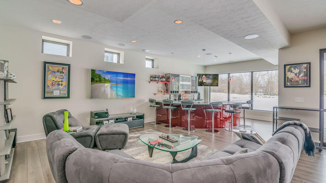 Modern Basement With Greige Laminate Flooring