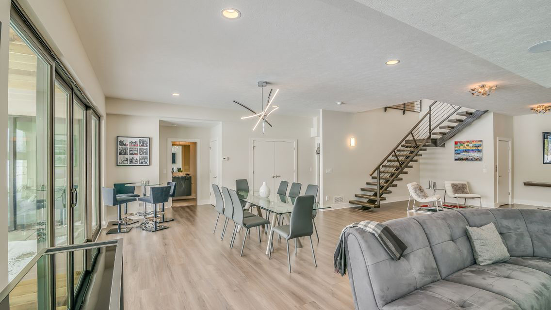 Open Concept Basement With Greige Laminate Flooring