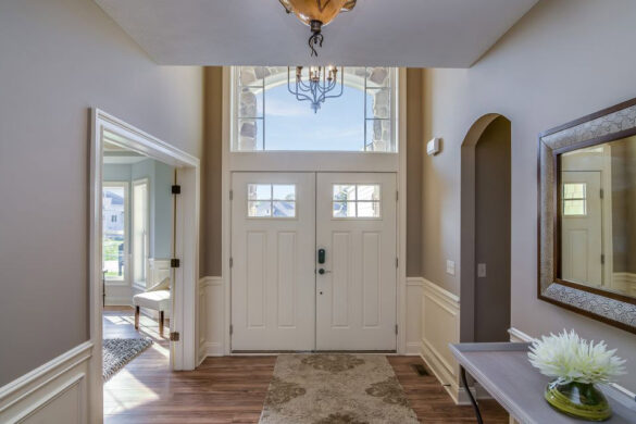 Welcoming Entry Hall With Golden Brown Flooring bl-000678