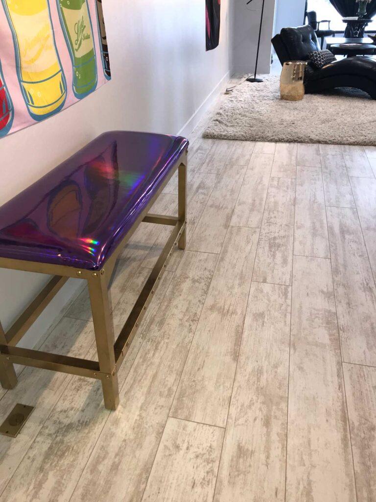 brow studio with whitewashed laminate flooring