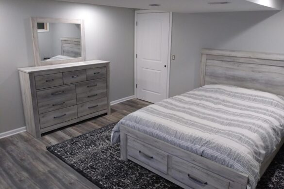 guest bedroom with Kronotex robusto harbour oak grey laminate flooring
