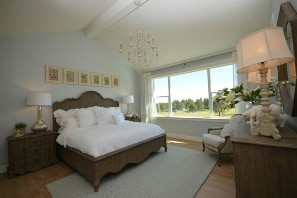 master bedroom with quick step malted tawny oak laminate