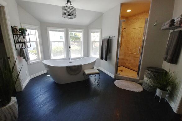 modern bathroom with quick-step naturetek envique tuxedo pine laminate flooring