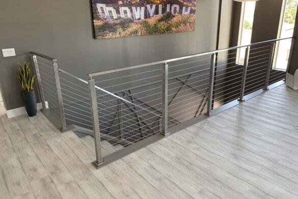 modern staircase with Quick-Step NatureTEK Plus Envique Urban Concrete Oak IMUS1861 Laminate Flooring